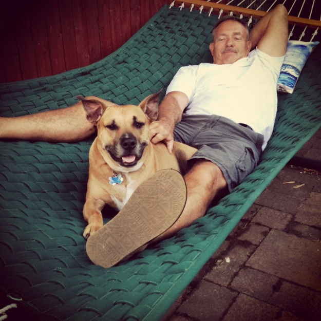 on the hammock with his pop